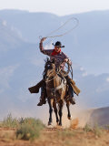 Cowboy Running with Rope Lassoo in Hand, Flitner Ranch, Shell, Wyoming, USA Photographic Print by Carol Walker