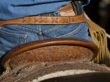 Detail of Back of Cowboy's Saddle, Jeans and Chaps, Sombrero Ranch, Craig, Colorado, USA Photographic Print by Carol Walker