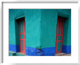 Brightly Painted Corner House in Chinique, Quiche, Guatemala Print by Jeffrey Becom
