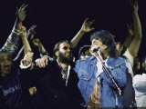 Former Beatles Ringo Starr and Paul Mccartney Performing Fototryk i høj kvalitet