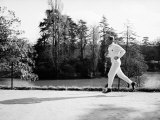French Journalist and Politician Jean-Jacques Servan Schreiber Jogging Near Home Lmina fotogrfica de primera calidad por Carlo Bavagnoli