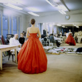Fashion Designer Christian Dior Commenting on Red Gown for His New Collection Prior to Showing Fototryk i høj kvalitet af Loomis Dean