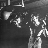 Actor Jack Palance in Boxing Trunks and Gloves, Hitting Punching Bag Fototryk i hj kvalitet af Loomis Dean