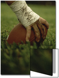 Close-up of the Hand of an American Football Player Holding a Football Posters