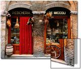 Fahrrad vor einem historischen Lebensmittelladen abgestellt, Siena, Toskana, Italien Kunst von John Elk III
