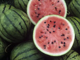 Watermelons, Entire and Opened Photographic Print by David Cavagnaro