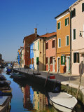 Colorful Houses and Boats Reflecting in Canal Burano, Italy Photographic Print by Adam Jones