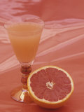 Grapefruit and Juice Photographic Print by Wally Eberhart