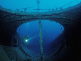 Scuba Diver Exploring a Shipwreck, Papua New Guinea, Coral Sea Photographic Print by Reinhard Dirscherl
