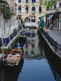 Boats Docked Along One of Many Inner Canals of Venice, Italy Photographic Print by Adam Jones