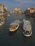 Water Taxis on Grand Canal with Santa Maria Della Salute in the Distance, Venice, Italy Photographic Print by Adam Jones