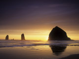 Haystack Rock and Other Sea Stacks Silhouetted at Sunset, Cannon Beach, Oregon, USA Photographic Print by Adam Jones
