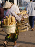 Woman Carrying Baskets of French Bread, Talaat Sao Market in Vientiane, Laos, Southeast Asia Photographic Print by Alain Evrard