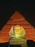 Sphinx and One of the Pyramids Illuminated at Night, Giza, Cairo, Egypt Photographic Print by Nigel Francis