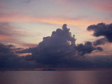 Towering Dark Grey Clouds in a Pink and Blue Sky over the Sea in Malaysia, Southeast Asia Photographic Print by James Green