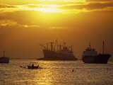 Cargo Ships and Outrigger Canoe in Manila Bay at Sunset, in the Philippines, Southeast Asia Photographic Print by Robert Francis
