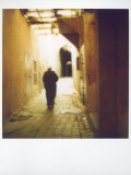 Polaroid Image of Man Walking Along Narrow, Dimly-Lit Street in the Medina, Fez, Morocco Photographic Print by Lee Frost