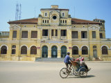 Cyclo Passing the Old Post Office in Phnom Penh in Cambodia, Indochina, Southeast Asia Photographic Print by Tim Hall