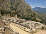 Ruins of the Temple of Apollo, with Hills in the Background, at Delphi, Greece Photographic Print by Ken Gillham