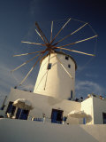 Traditional Thatched Windmill in the Village of Oia, Santorini, Cyclades Islands, Greek Islands Photographic Print by Lee Frost