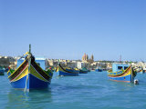 Painted Boats in the Harbour at Marsaxlokk, Malta, Mediterranean, Europe Photographic Print by Nigel Francis