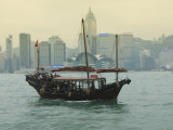 One of the Last Remaining Chinese Junk Boats Sails on Victoria Harbour, Hong Kong, China Photographic Print by Amanda Hall