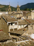 Old Buildings with Tiled Roofs and a Church Behind at Estella on the Camino in Navarre, Spain Photographic Print by Ken Gillham