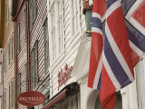 Wooden Merchants Premises and Norwegian Flag, Bryggen Old Harbour Side, Bergen, Norway, Scandinavia Photographic Print by James Emmerson