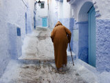 Old Man Walking in a Typical Street in Chefchaouen, Rif Mountains Region, Morocco Photographic Print by Levy Yadid