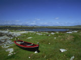 Boat on Green Foreshore, Landscape in Connemara, County Galway, Connacht, Republic of Ireland Photographic Print by Lawrence Graham