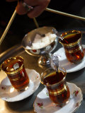 Hand Holding a Tray with Turkish Tea, Istanbul, Turkey, Europe Photographic Print by Levy Yadid
