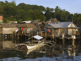 Stilt Houses and Catamaran Fishing Boat, Coron Town, Busuanga Island, Palawan Province, Philippines Photographic Print by Kober Christian