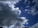 Dark Clouds and Blue Sky Photographic Print by Hunter David