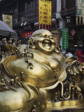 Golden Statue of a Reclining Laughing Buddha, Hangzhou, Zhejiang Province, China Photographic Print by Kober Christian