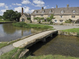 Footbridge over River Eye, Lower Slaughter Village, the Cotswolds, Gloucestershire, England, UK Photographic Print by Hughes David