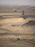 Man on Mule-Back Traverses the Desert around the Ancient City of Old Dongola, Sudan, Africa Photographie par Mcconnell Andrew