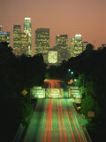 Los Angeles Skyline and Freeway, Illuminated at Night, California, USA Photographic Print by Howell Michael
