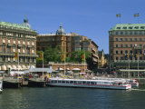 Sightseeing Boat and Waterfront Hotels and Cafes in the City Centre, Stockholm, Sweden, Scandinavia Photographic Print by Maxwell Duncan