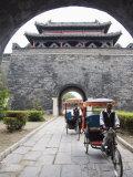Tourist Rickshaw at a City Gate Watch Tower, Qufu City, Shandong Province, China Reprodukcja zdjęcia autor Kober Christian