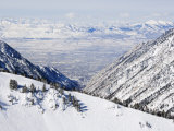 Salt Lake Valley and Fresh Powder Tracks at Alta, Alta Ski Resort, Salt Lake City, Utah, USA Photographic Print by Kober Christian