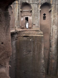 Priest Stands at the Entrance to the Rock-Hewn Church of Bet Gabriel-Rufael, Lalibela, Ethiopia Photographic Print by Mcconnell Andrew