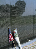Flag and Flowers Against the List of Names on the Vietnam Veterans Memorial in Washington D.C., USA Photographic Print by Hodson Jonathan