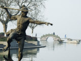Statue of a Spear Fisherman in the Waters of West Lake, Hangzhou, Zhejiang Province, China Photographic Print by Kober Christian