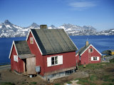 Wooden Houses on the Coast, with Mountains in the Background, at Ammassalik, East Greenland Photographic Print by Lomax David