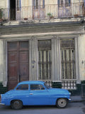 Blue Car Parked Outside a Shabby House in Old Havana, Cuba, West Indies, Central America Photographic Print by Mawson Mark