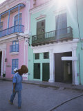 Man with Guitar Walking Past Coloured Buildings in Central Havana, Cuba, West Indies Photographic Print by McCoy Aaron