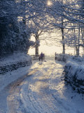 Man and Child Walking Down a Snow Covered Road in Winter Near Arthington, West Yorkshire, England Photographic Print by Hodson Jonathan