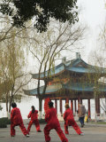 Women Practising Tai Chi in Front of a Pavilion on West Lake, Hangzhou, Zhejiang Province, China Photographic Print by Kober Christian