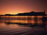 Reflections in the Sea of the Pier at Brighton at Sunset, Sussex, England, United Kingdom, Europe Photographic Print by Rainford Roy