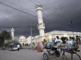 Storm Clouds Gather over a Mosque in the Center of Hargeisa, Capital of Somaliland, Somalia, Africa Photographic Print by Mcconnell Andrew